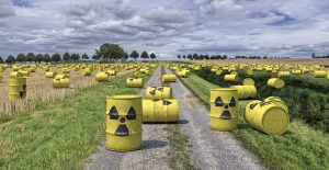 trash cans scattered in field